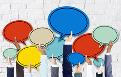 Business People's Hands Holding Speech Bubbles Stock Photos