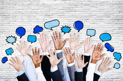 Business People's Hands Raised with Speech Bubble Stock Image
