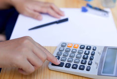 Business people's working hand on calculator Royalty Free Stock Photography