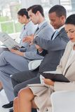 Business people sat in line Stock Photography