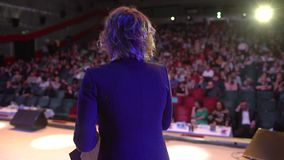 Business people seminar audience from stage, conference meeting training female woman speaker coach group businesswoman