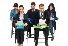 Business people at seminar reading Royalty Free Stock Photo