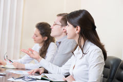 Business people at seminar Stock Image