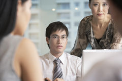 Business People In Serious Discussion Stock Image