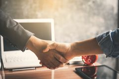 Business people shake hand in office Royalty Free Stock Photos