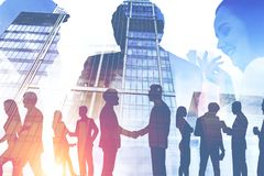 Business people shake hands in city, managers stock photo