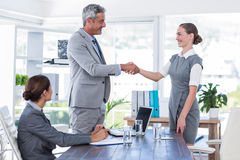 Business people shake hands during interview Royalty Free Stock Photo