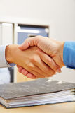 Business people shake hands in office Stock Photography
