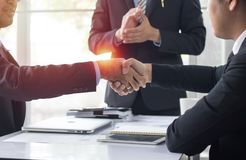 Business people shaking hand to cooperate and deal in business s. Business people shaking hand to cooperate and deal in business royalty free stock images
