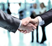 Business people shaking hands. Close-up of business people shaking hands to confirm their partnership royalty free stock photo