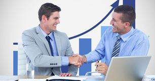 Business people shaking hands against graph Royalty Free Stock Photos