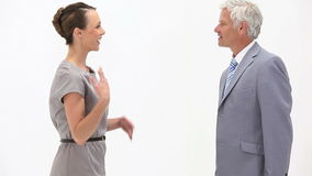 Business people shaking hands against a white background. Video of business people shaking hands against a white background stock video footage