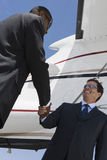 Business People Shaking Hands At Airfield Stock Photos