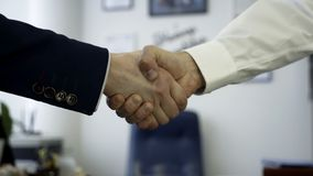 Business people shaking hands as a sign of agreement. Close up for firm handshake of two business partners in the office stock photos