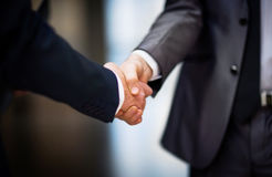 Business people shaking hands. On the background of the office Royalty Free Stock Photography