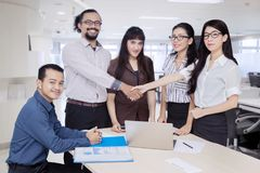 Business people shaking hands in the boardroom Stock Images