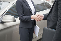 Business People Shaking Hands By Car Royalty Free Stock Images