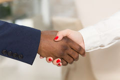 Business people shaking hands. Close-up of business people shaking hands. Man and women trying to show mutual cooperation and agreement betweent their companies Stock Photography
