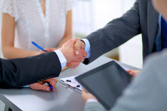 Business people shaking hands, finishing up a Stock Image