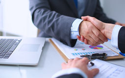 Business people shaking hands, finishing up a Royalty Free Stock Image
