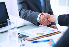 Business people shaking hands, finishing up a Royalty Free Stock Photo