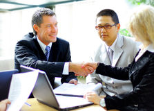 Business people shaking hands, finishing up a meet Royalty Free Stock Image