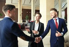 Business people shaking hands, finishing up a meeting. Stock Images