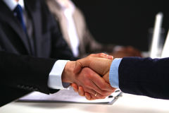 Business people shaking hands, finishing up a Stock Photography