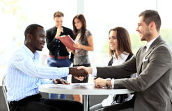 Business people shaking hands, finishing up meeting Stock Photos