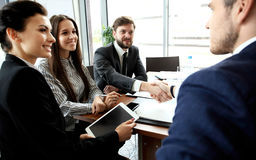 Business people shaking hands, finishing up meeting Royalty Free Stock Photo