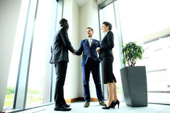Business people shaking hands, finishing up meeting Royalty Free Stock Image