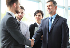 Business people shaking hands, finishing up a meeting. royalty free stock image