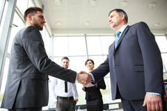 Business people shaking hands, finishing up a meeting. Royalty Free Stock Photo