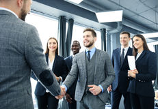Business people shaking hands, finishing up a meeting. Royalty Free Stock Images