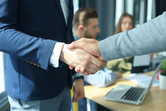 Business people shaking hands, finishing up a meeting. Stock Photos