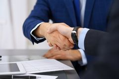 Business people shaking hands, finishing up a meeting. Audit, tax service or agreement concept.  Royalty Free Stock Photos