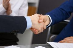 Business people shaking hands, finishing up a meeting. Audit, tax service or agreement concept.  Royalty Free Stock Images