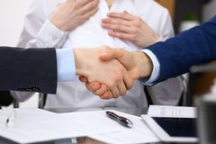 Business people shaking hands, finishing up a meeting. Audit, tax service or agreement concept.  Stock Images
