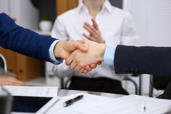 Business people shaking hands, finishing up a meeting. Audit, tax service or agreement concept.  Stock Photos