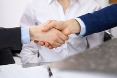 Business people shaking hands, finishing up a meeting. Audit, tax service or agreement concept.  Royalty Free Stock Photography
