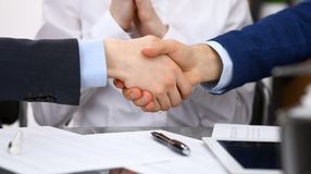 Business people shaking hands, finishing up a meeting. Audit, tax service or agreement concept.  Royalty Free Stock Photo