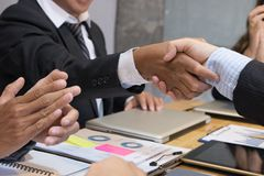 Business people shaking hands after finishing up a meeting. Busi Stock Photo