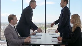 Business people shaking hands. Finishing up a meeting