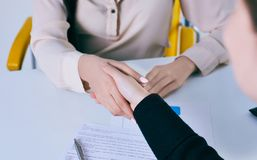 Business people shaking hands, finishing up a meeting. Friend welcome, thanks gesture, motivation, strike bargain. Business people shaking hands, finishing up a Stock Photos