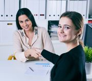 Business people shaking hands, finishing up a meeting. Friend welcome, thanks gesture, motivation, strike bargain. Business people shaking hands, finishing up a Royalty Free Stock Images