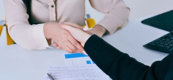 Business people shaking hands, finishing up a meeting. Friend welcome, thanks gesture, motivation, strike bargain. Business people shaking hands, finishing up a Stock Images