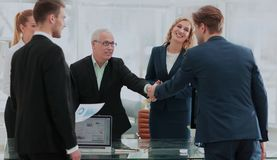 Business handshake and  people. Business people shaking hands, finishing up a meeting Royalty Free Stock Photos