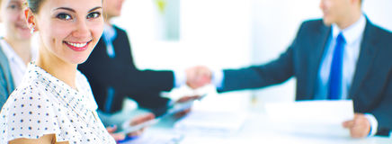 Business people shaking hands, finishing up a meeting. Business handshake. Business people shaking hands, finishing up a meeting Royalty Free Stock Photo