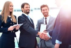 Business people shaking hands, finishing up a meeting. Image of business partners handshaking after signing contract Royalty Free Stock Photo