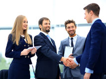 Business people shaking hands, finishing up a meeting. Image of business partners handshaking after signing contract Stock Photo